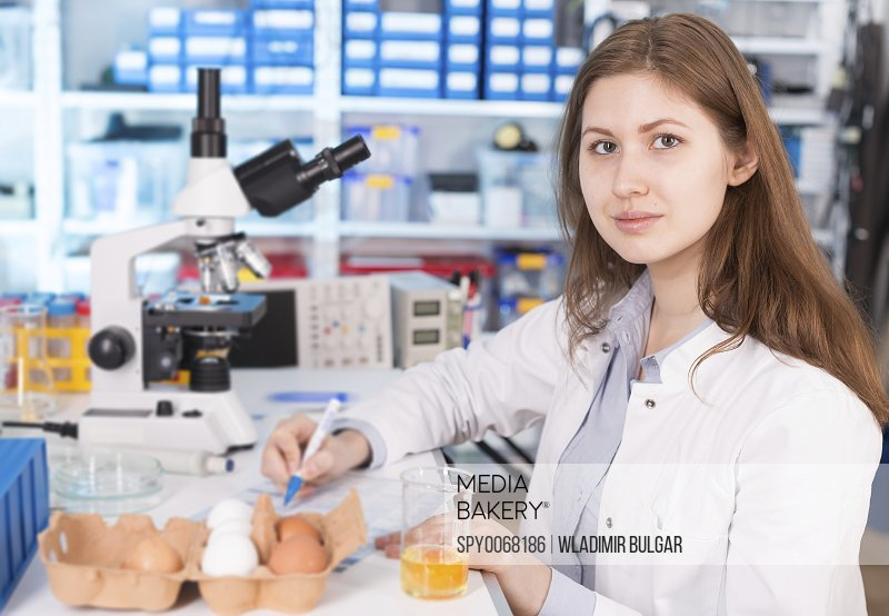 Lab technician testing eggs in lab