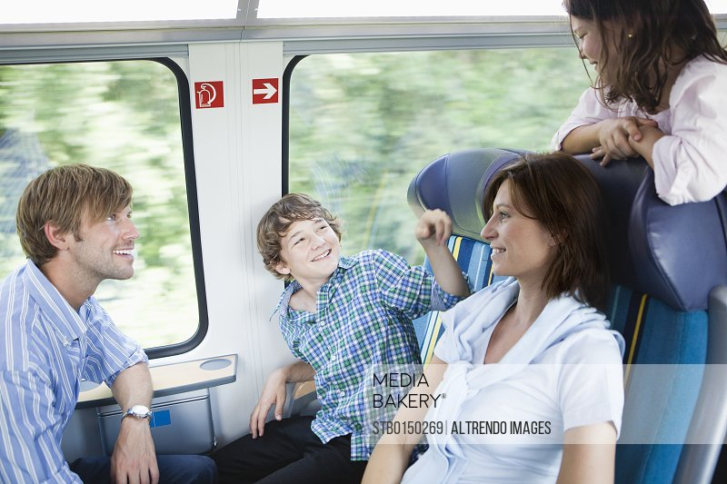 Young family traveling on train together