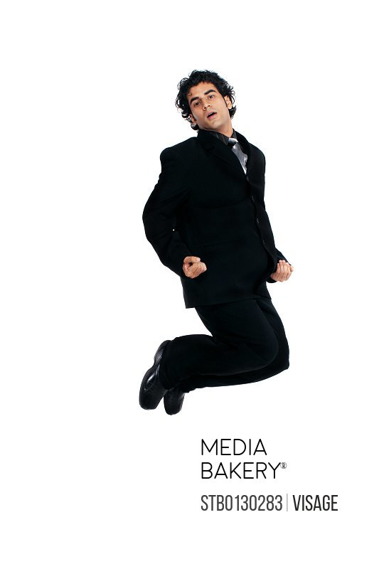A businessman jumping in happiness