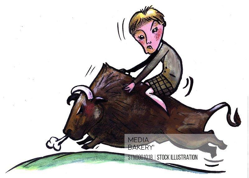 Woman riding on bull