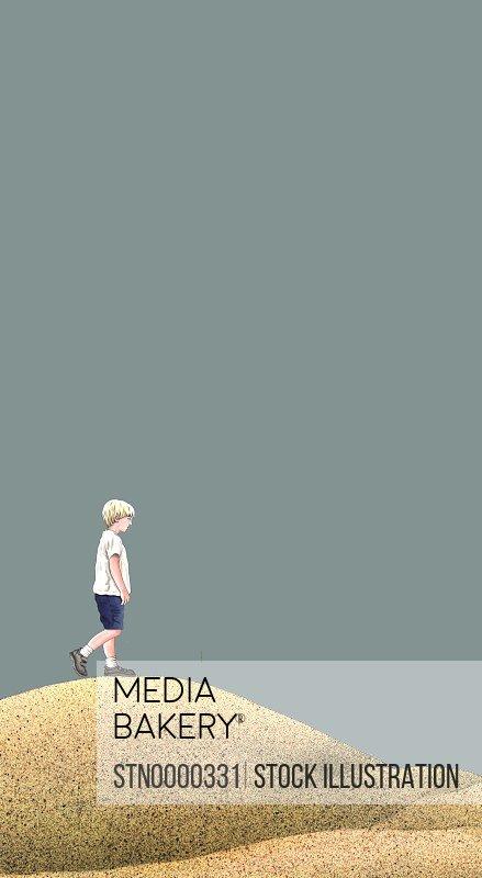 Boy standing on sand dune