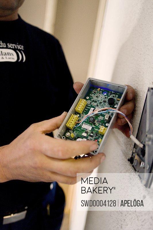 Man repairing access control system