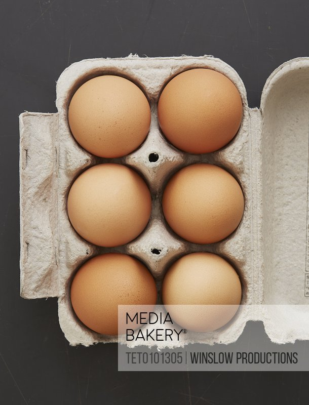 Overhead view of eggs in carton