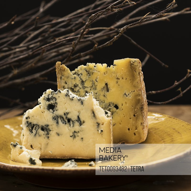 Blue cheese slices on plate studio shot