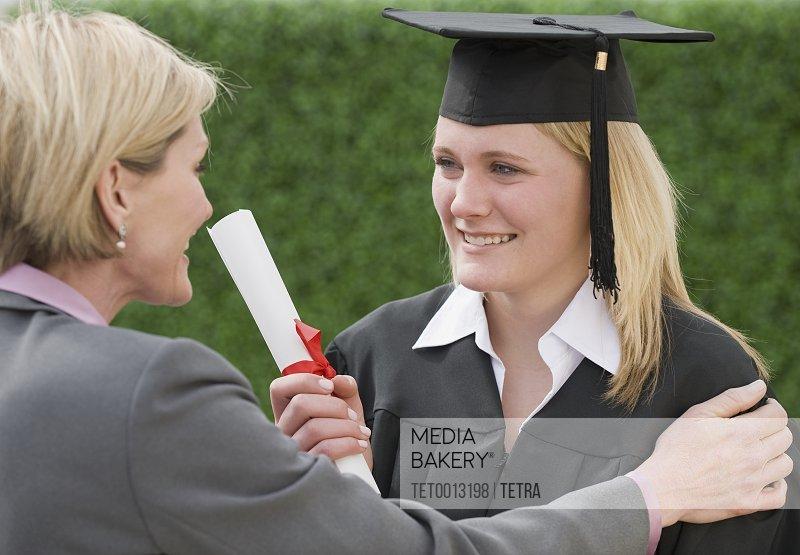 Mother congratulating graduate daughter