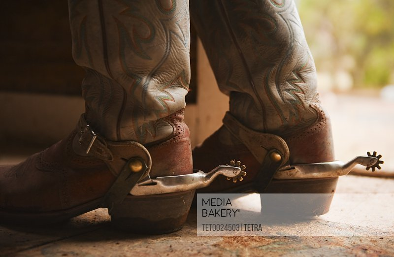 Photo by Tetra Images , Spurs on cowboy boots