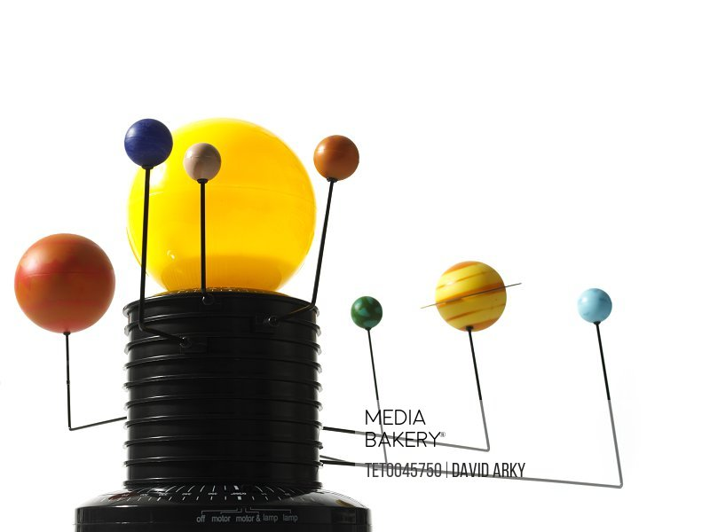 Photo by Tetra Images - Solar system model on white background