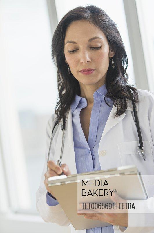 Female doctor holding medical document