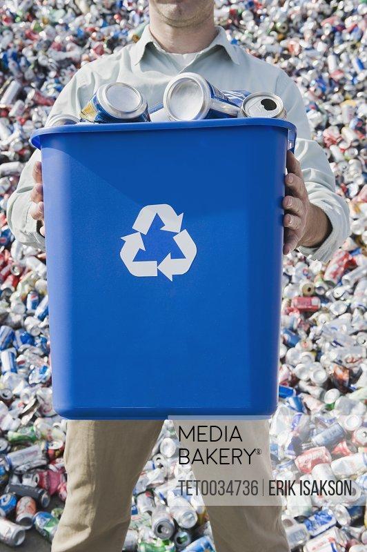 Man holding blue bin