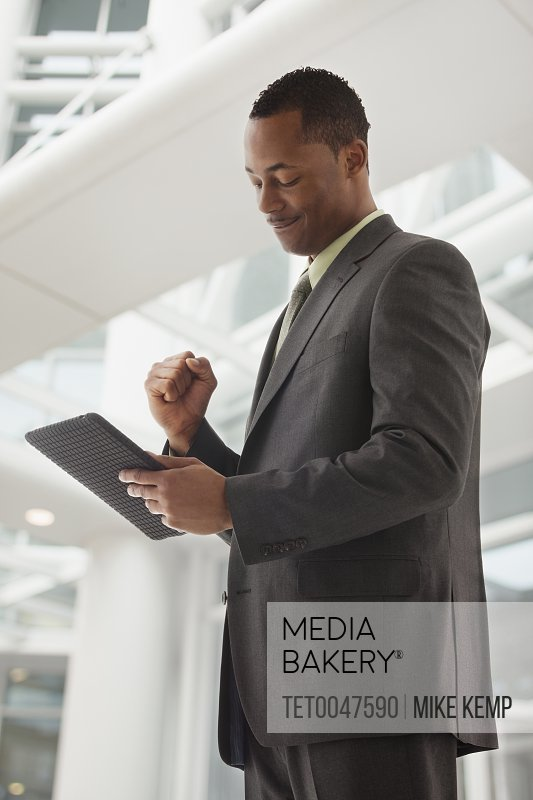 Content young businessman examining file