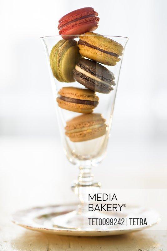 Macaroons inside drinking glass