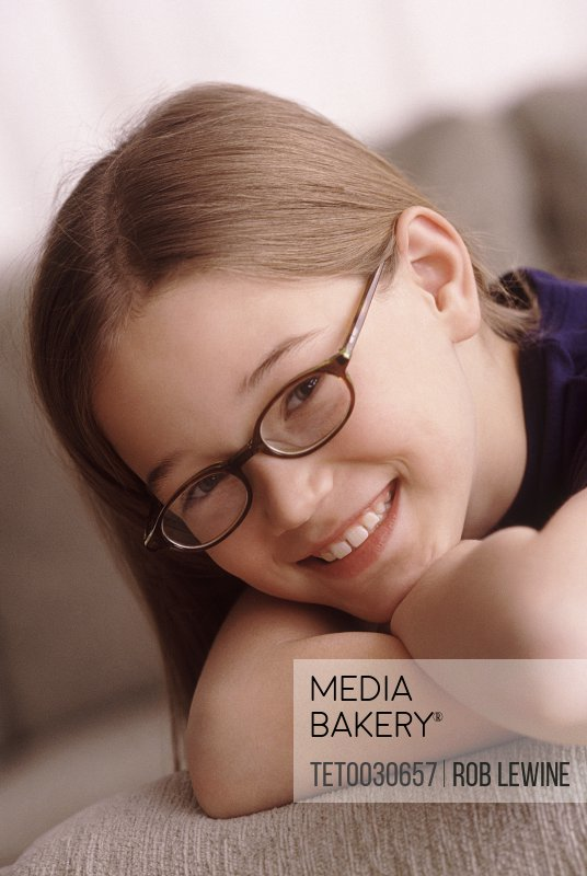 Portrait of a young girl wearing glasses