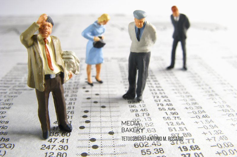 Business figurines on financial figures