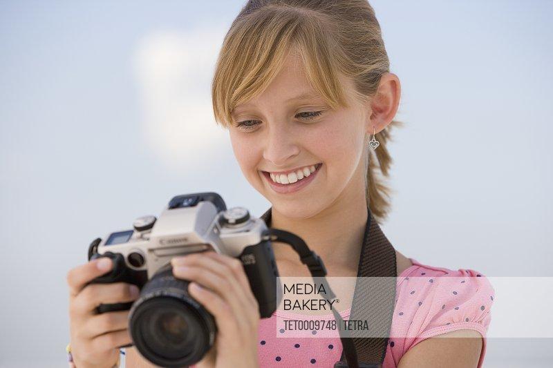 Teenaged girl looking at camera