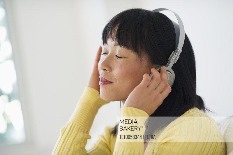 Smiling woman listening music