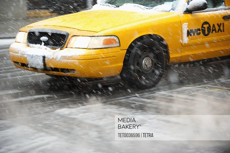 Usa New York New York City Close Up Of Yellow Cab On Street In Snow Stock Photo