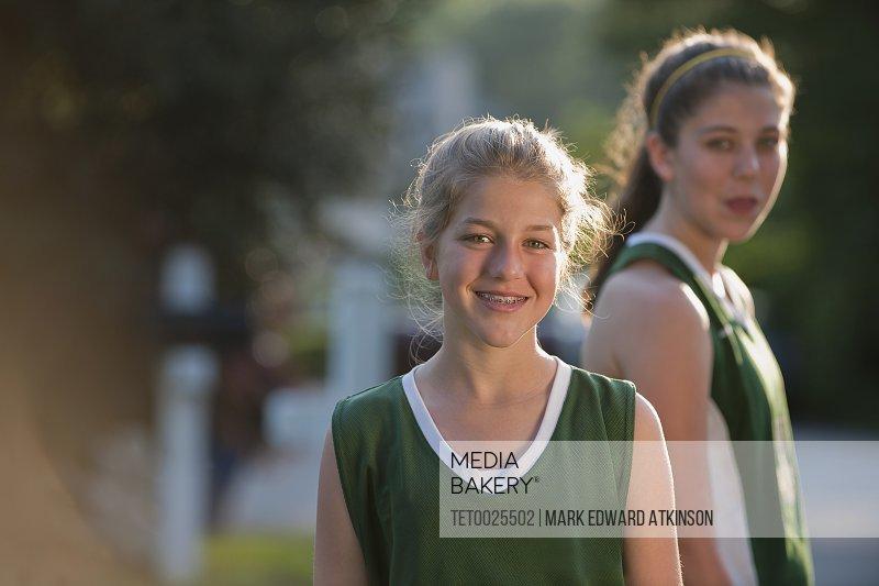 Girls in sports uniforms