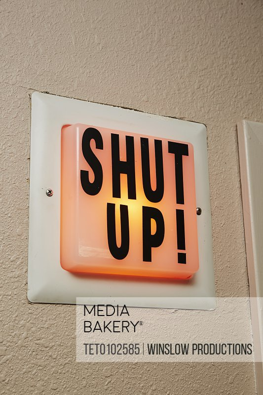 Shut up sign in radio broadcast booth