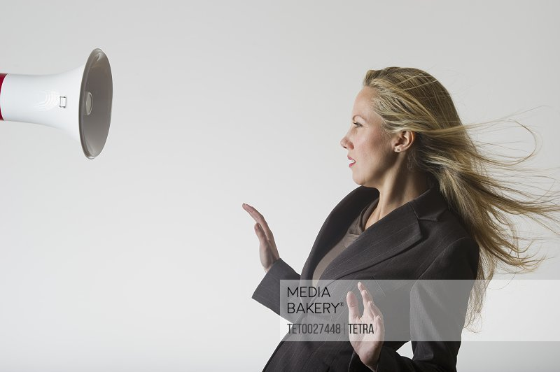 Bullhorn beside businesswoman