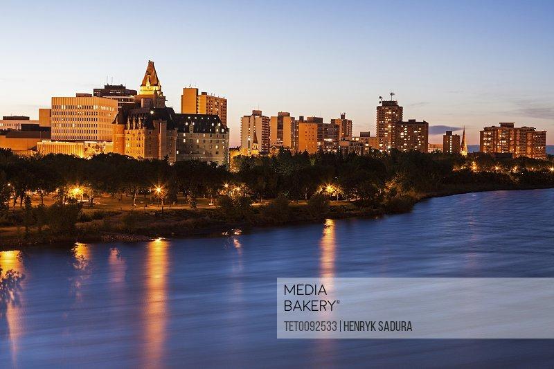 Illuminated cityscape at dusk