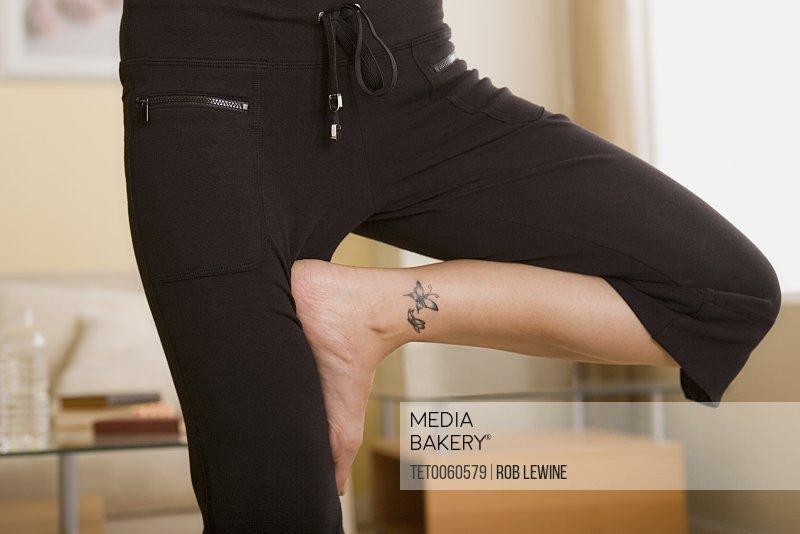 Legs of woman in yoga pose