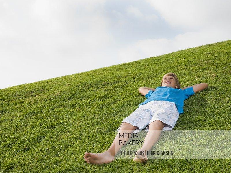 Boy resting on grass