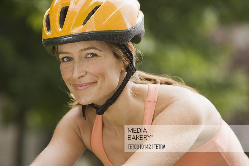 Woman wearing bicycle helmet