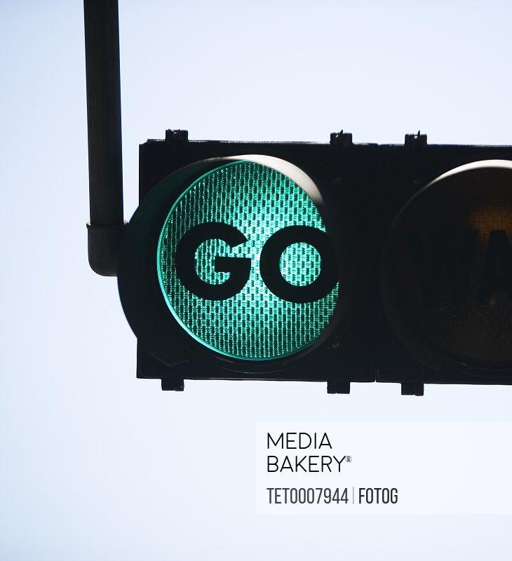 Green traffic light reading Go