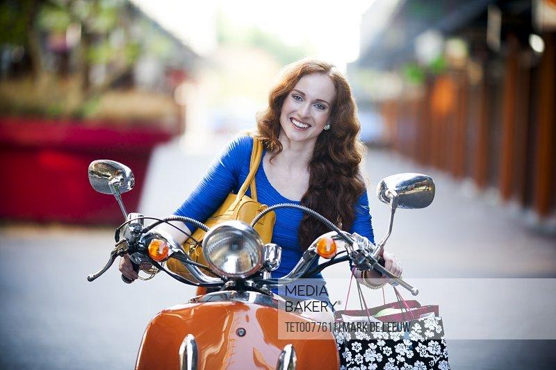 Elegant woman on motorcycle