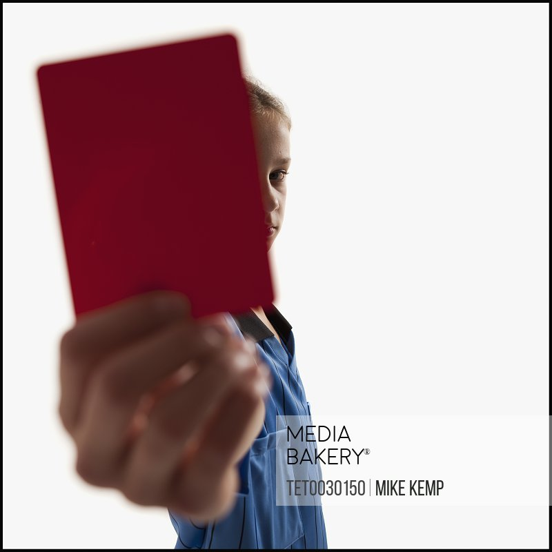 Young girl holding red card
