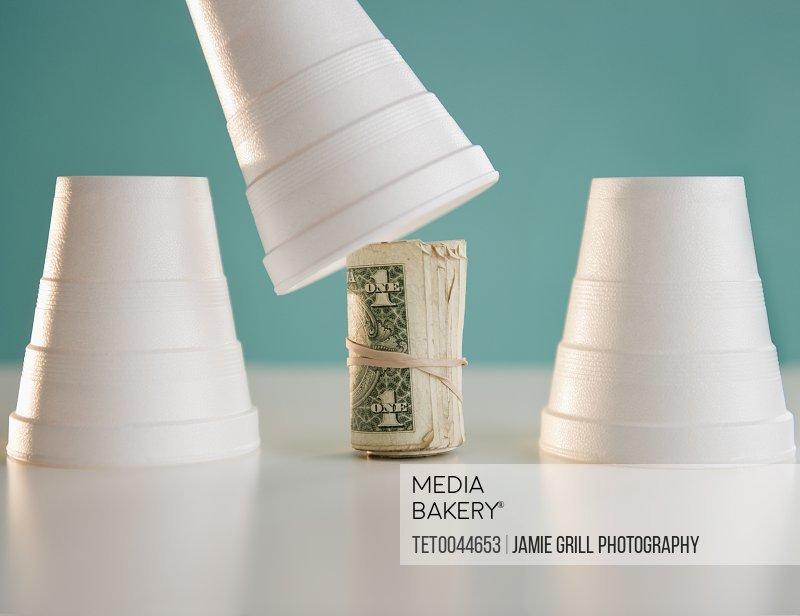 Studio shot of money under cup