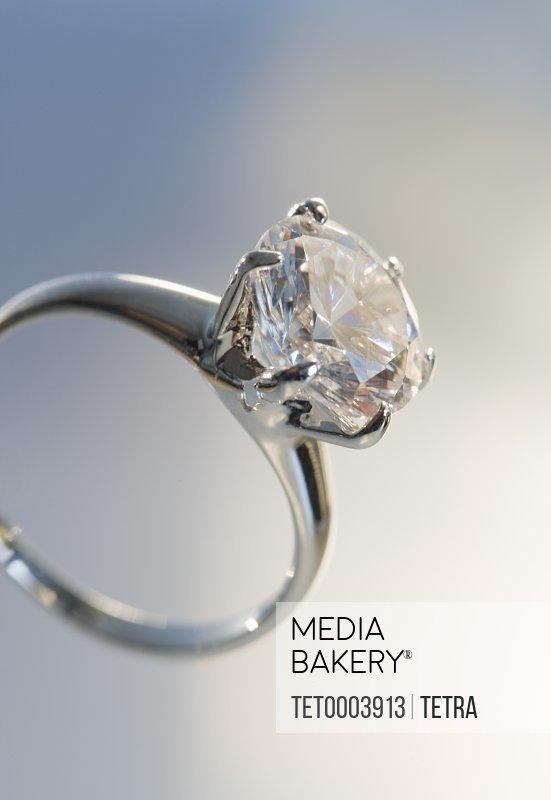 Diamond like ring in six pronged silver setting