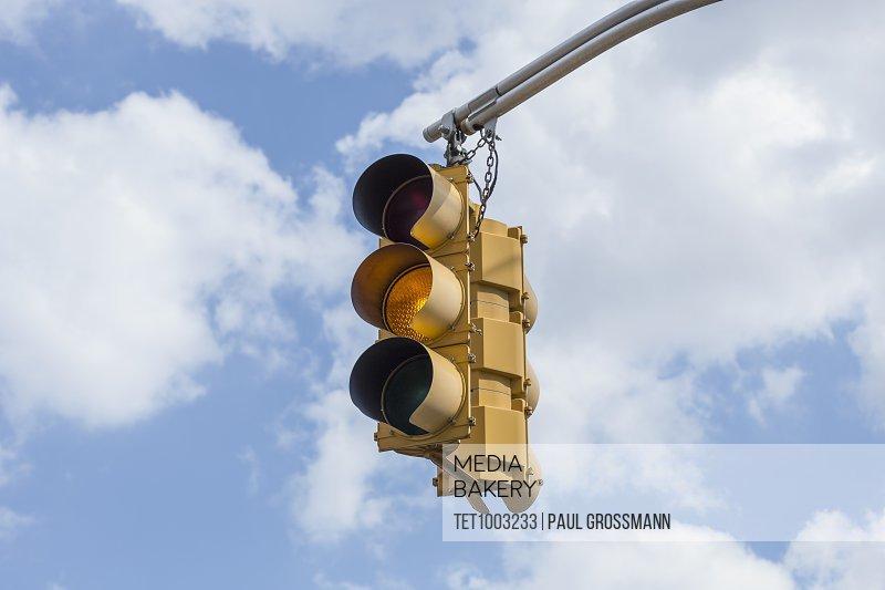Traffic light against sky