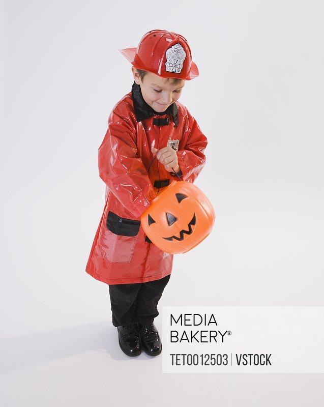 Boy dressed in fireman Halloween costume