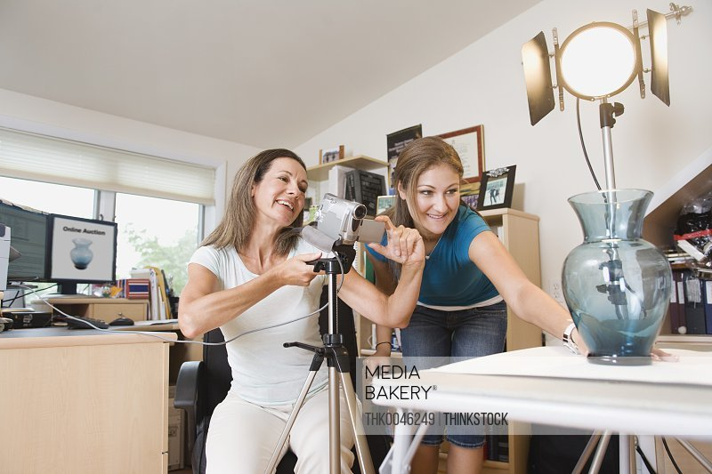 Mother and daughter taking a picture for online auction