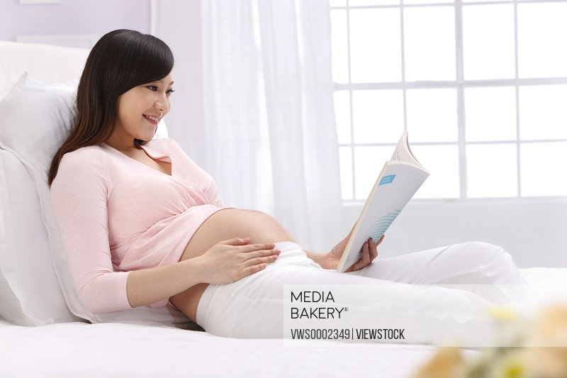 Pregnant woman reading book