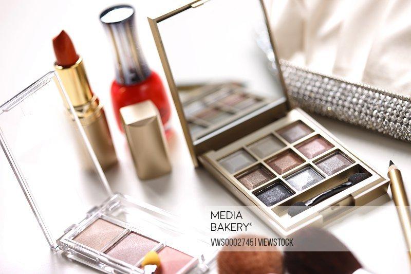 Powder foundation,makeup brush and lipstick