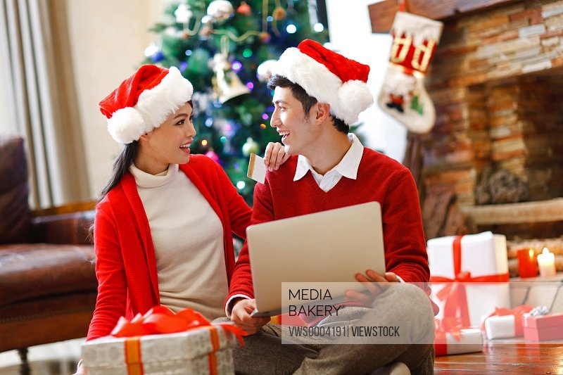 Young couple spend Christmas time