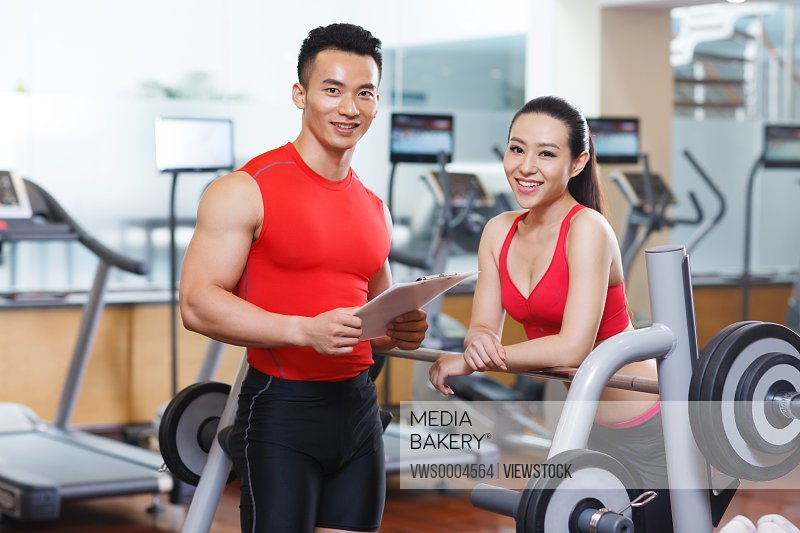 Young men and woman in gym