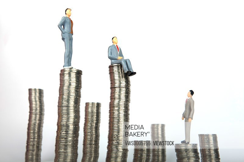 Businessmen with stack of coins