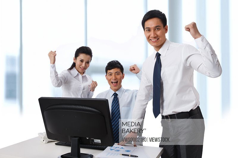 Enthusiastic business people at office