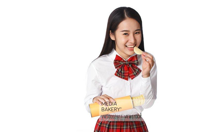 Student girl eating chips
