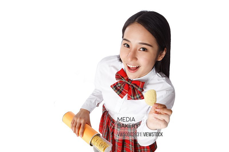 Student girl eating chips