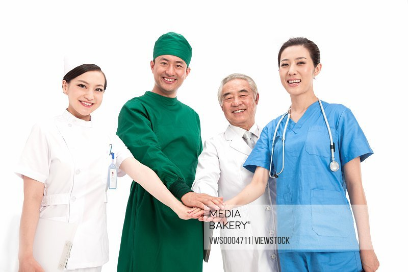 Four portrait of doctors on white background