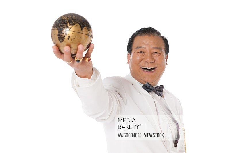 Successful man holding a globe