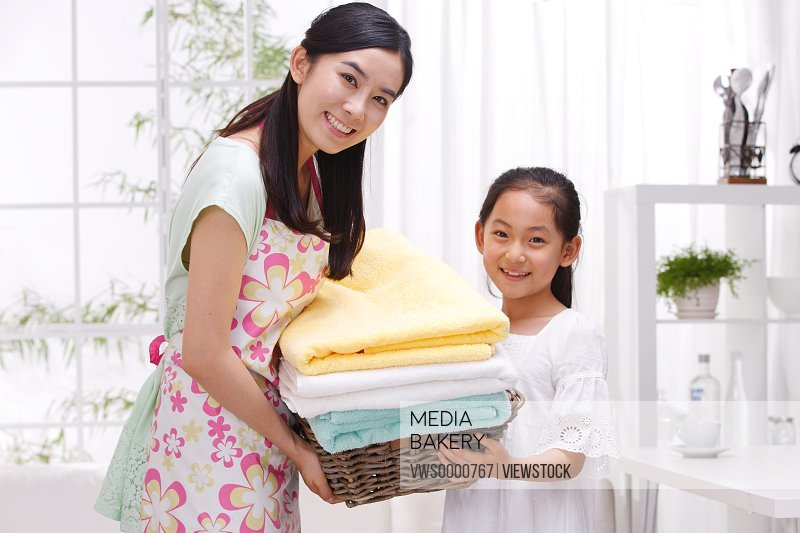 Mother and daugher holding towels