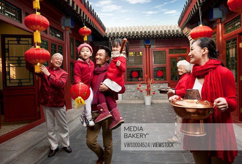Oriental family in Spring Festival