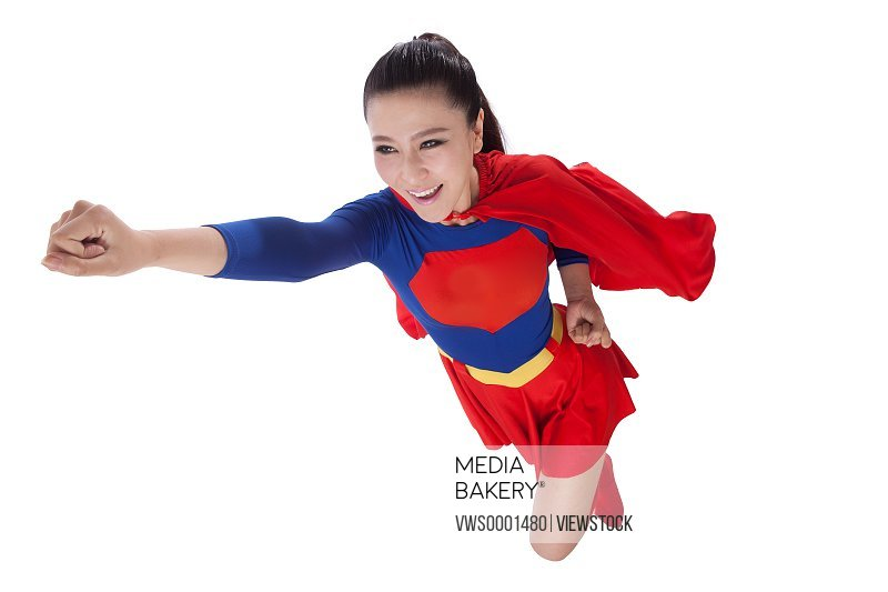 Young woman in superman outfit