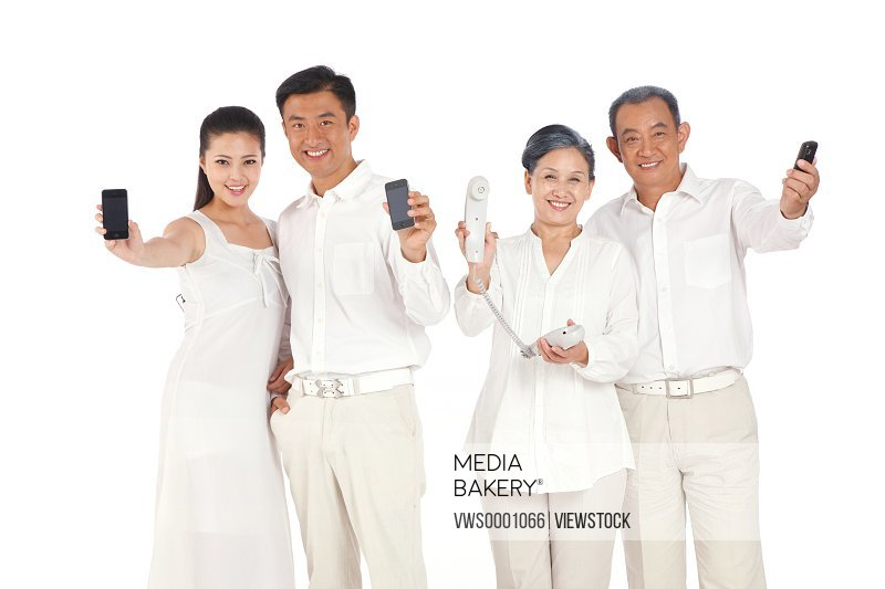 Whole family holding cell phone