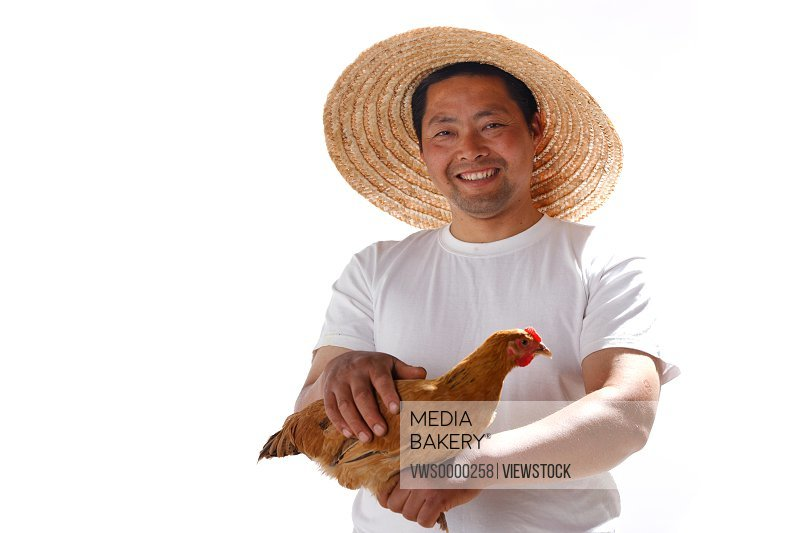 Farmer holding chicken